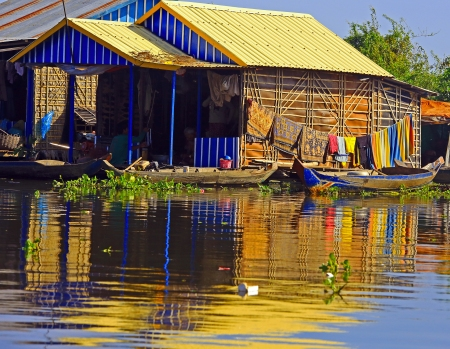Colorful homestead reflections Floating Villages Cambodia