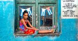 _E7A6456 Young girl sitting in window - surprise web ready